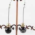 dangling gold champagne and black acrylic ball earrings