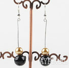 dangling gold and black acrylic ball earrings