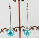 dangling white and sea blue acrylic ball earrings under $ 40