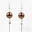 Dangle style brown round seashell earrings with long tail