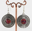 Lovely CCB silver like earrings with red beads in center
