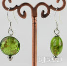 lovely round shape green colored glaze earrings