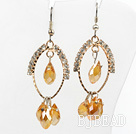 lovely yellow crystal earrings on gold tone loop with rhinestone