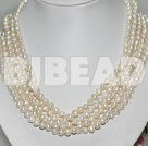 multi strand white pearl necklace with moonlight clasp