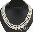 graceful three strand white pearl necklace with gold color clasp