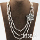 Three strand rice shape freshwater pearl necklace with flower accessories