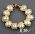 high quality egg shape light yellow sea shell beads bracelet with gold plated clasp