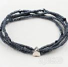 elastic four strand black crystal and glass beads bracelet