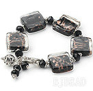 brown colored glaze and  black crystal bracelet with toggle clasp under $ 40