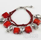 red colored glaze and fish charm bracelet with extendable chain under $ 40