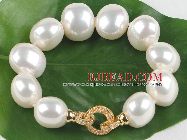 high quality egg shape white sea shell beads bracelet with gold plated clasp