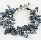 Two strand black teeth shape black pearl bracelet with toggle clasp