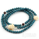 Cyanite Beaded Stretch Bracelet with Corozo Nut Buddha's Head and Rose Flower and Garnet and Sterling Silver Spacer Beads( Can also be Necklace )
