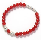 A Grade 6mm Round Carnelian and Double Fish Stretch Bangle Bracelet