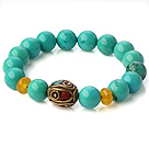 Popular Xinjiang Green Turquoise And Beeswax Beads Stretch Bracelet With Tibetan Charm under $ 40
