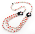 Three Layer White Freshwater Pearl and Pink Coral and Black Agate Donut Necklace under $ 40