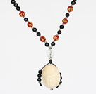 Obsidian Beads and Agate Necklace with Corozo Nut Laugh Baddha Pendant and Silver Beads