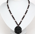Obsidian Beads and White Porcelain Stone Necklace with Laugh Baddha Pendant