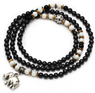 Black Color Candy Jade 4 Wrap Stretch Bangle Bracelet with White Porcelain Stone and Elephant Accessories under $ 40