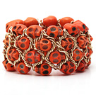 Fashion Style Dyed Orange Yellow Turquoise Skull Stretch Cuff Bracelet with Yellow Color Metal Chain