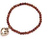 beautiful round goldstone and tibet silver peach heart charm beaded bracelet under $ 40