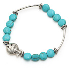 lovely 8mm flat round blue turquoise and tibet silver tube fish charm bracelet under $ 40
