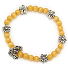beautiful yellow round cats eye and tibet silver flower charm beaded bracelet
