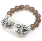 fashion gray freshwater pearl white hollow shell and facted gray agate bracelet with colorful rhinestone ball