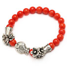 fashion 7mm orange red round coral and tibet silver fish horn flower charm beaded bracelet under $ 40