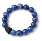 Trendy Single Strand 12mm Round Lapis Beads Bracelet with Wood Lotus Accessory under $ 40
