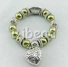 green acrylic pearl tibet silver stretch bracelet under $ 40